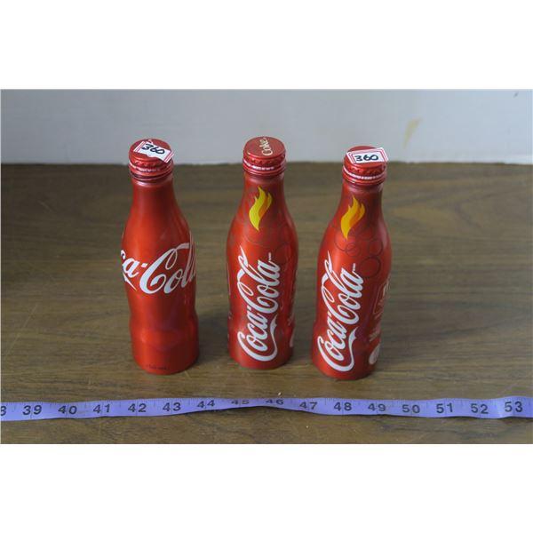 3 Tin Coca Cola Bottles, 1 Unopened