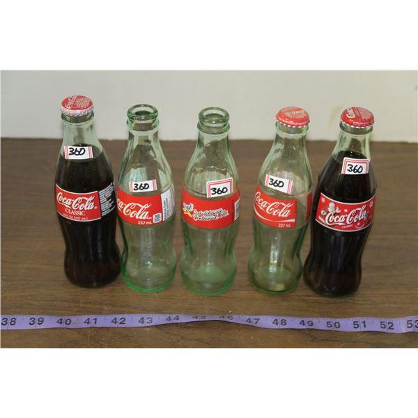 5 glass Coke bottles