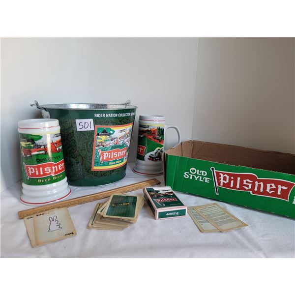 Group of Pilsner. Box, ice bucket, collector Beer steins and a deck of playing cards.