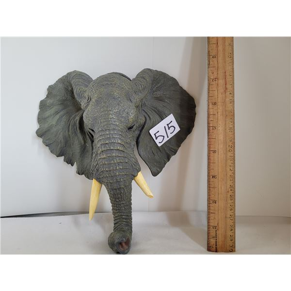 Elephant wall decor. Trunk acts as a hook for light objects.
