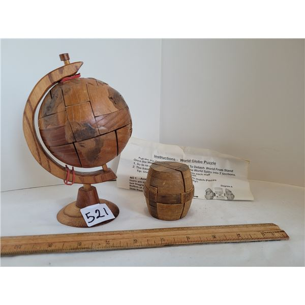 Wood 3D puzzles. Globe with instructions and a wooden barrel.
