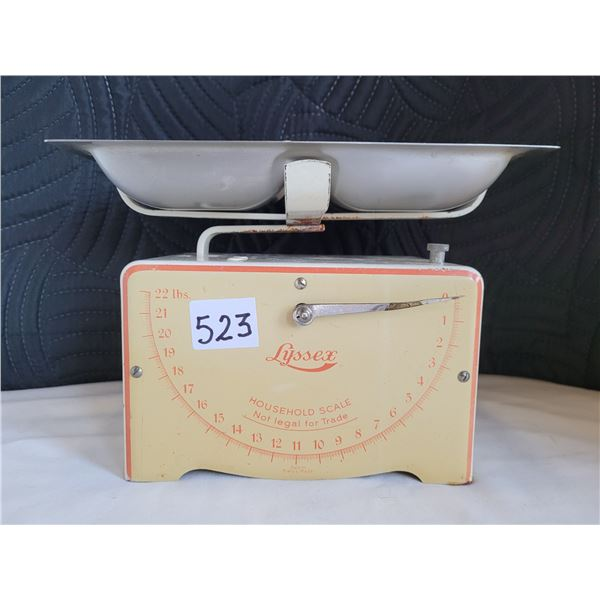 Vintage metal Lyssex household scale with tray.