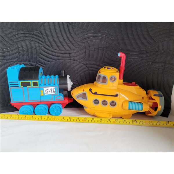 The Beatles yellow submarine with opening sides. Also Building blocks of Thomas the Train.