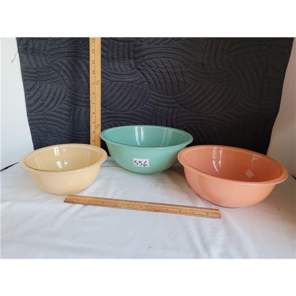 1980's pyrex nesting bowls. Aqua, Peach & Yellow. Pastel clear bottoms.