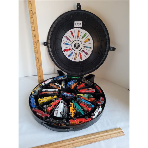 Hot wheels carry case filled with misc. Toy cars.