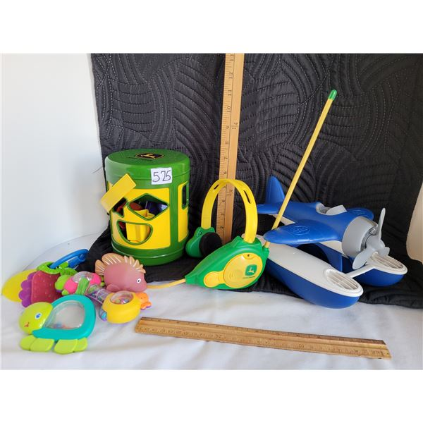 Group of Toys including a John Deere head set and a shape matching bucket.