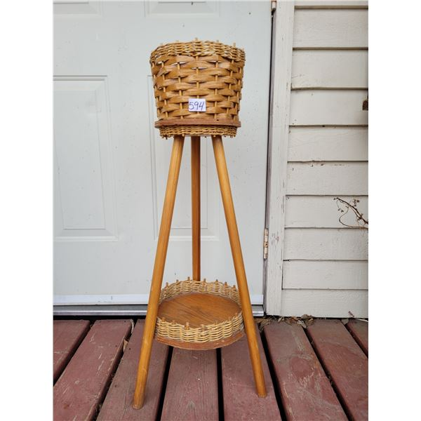 Wicker and wood 2 level plant stand.