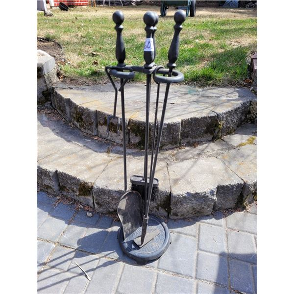 Cast iron fire place tool set.