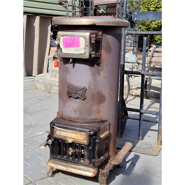 Old Acme stove/ heater.