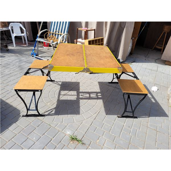 Vintage fold away unique travel table for 4.  Very good condition.