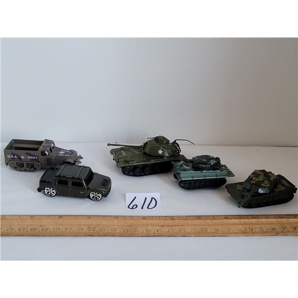 Small army toys. 3 tanks, half track and personnel carrier.