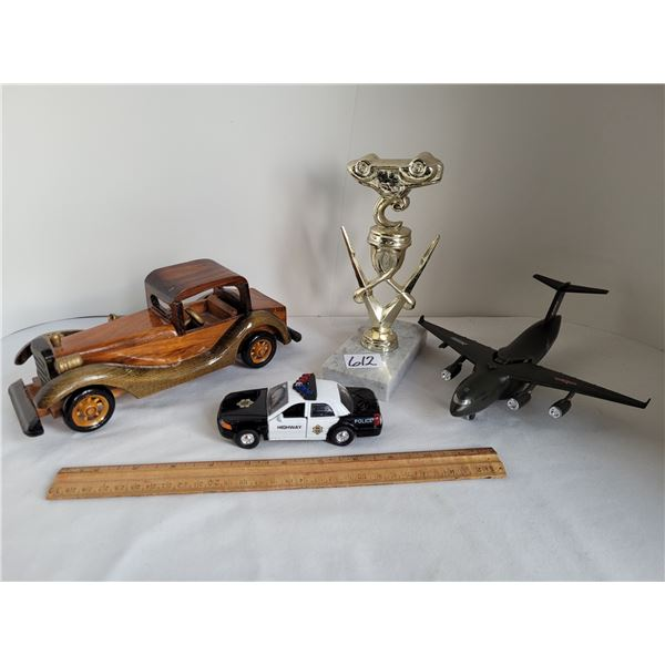 Metal & granite demolition trophy, wood car, military cargo plane, police car (moving parts).