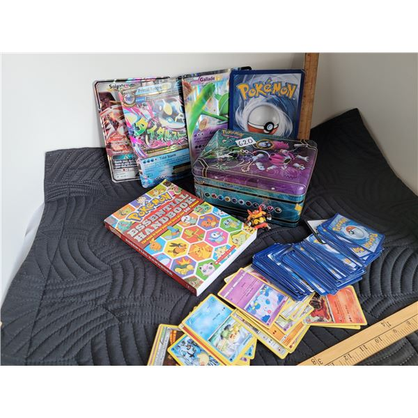 Pokemon handbook, unchecked cards, trading card tin and large cards.