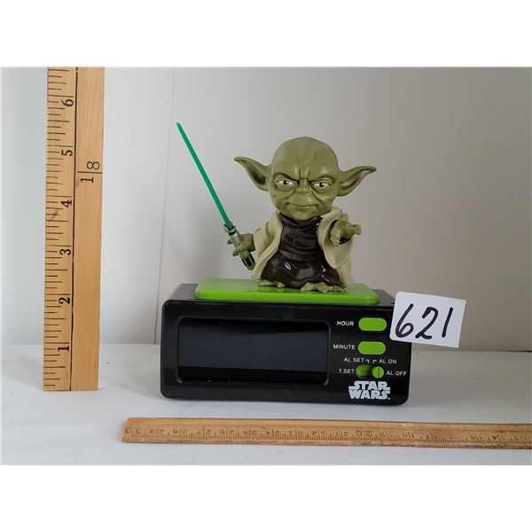 """Lucas film Yoda alarm clock.  Battery operated and at alarm says """"May the force be with you"""""""