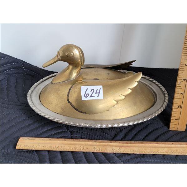 Vintage Brass duck on a steel nest.