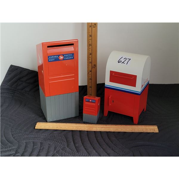 Canada Post replica mailbox banks and a stamp roll dispenser.