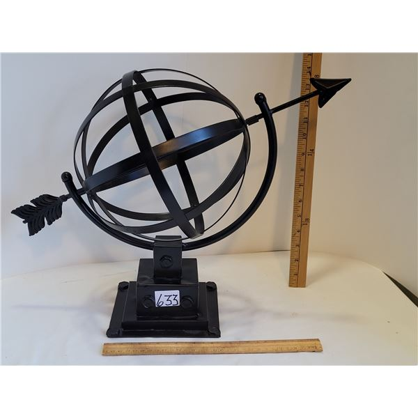 Spinning Metal globe and arrow .