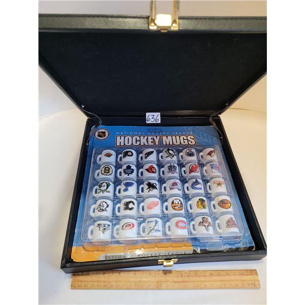 Vinyl case containing 30 original packaged NHL Hockey mini team mugs.