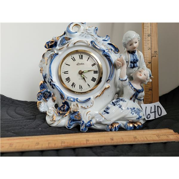 Vintage porcelain china clock depicting French Provincial couple. Made in Japan