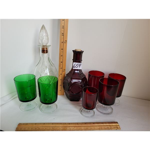 Cranberry & clear wine decanters with stemmed cranberry & lime coloured glasses.
