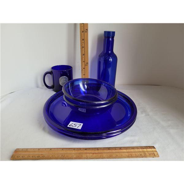 Cobalt blue glass set of 2 dinner plates and bowls, U of A mug and a bottle.