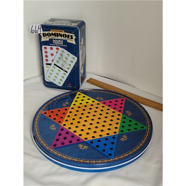 Double twelve dominos game, checkers, chess, and chinese checkers in tin containers.