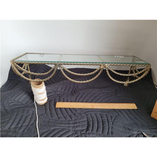 Vintage brass and glass wall shelf.