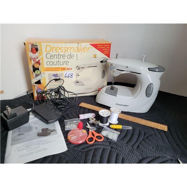Dressmaker compact sewing machine & accessories.