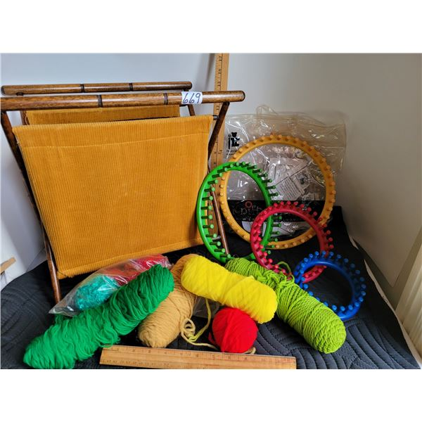 Folding knitting basket, wool, and a set of Knifty Knitter spools.