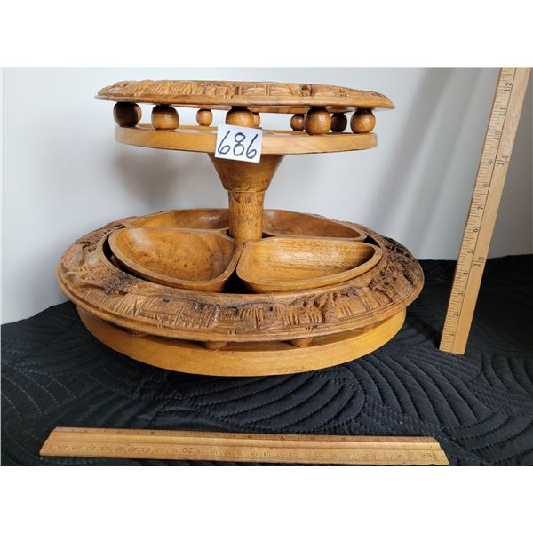 Vintage wood, lazy susan server featuring carvings of grass huts, water buffalo & palm trees.