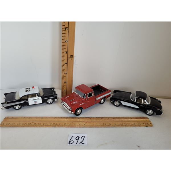 1957 lot. Chey Belair 1/40, Corvette 1/34, Cameo Pickup 1/38. All have opening doors.