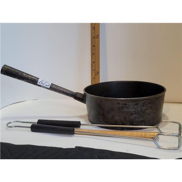 Cast iron long handle camping pot and tongs.