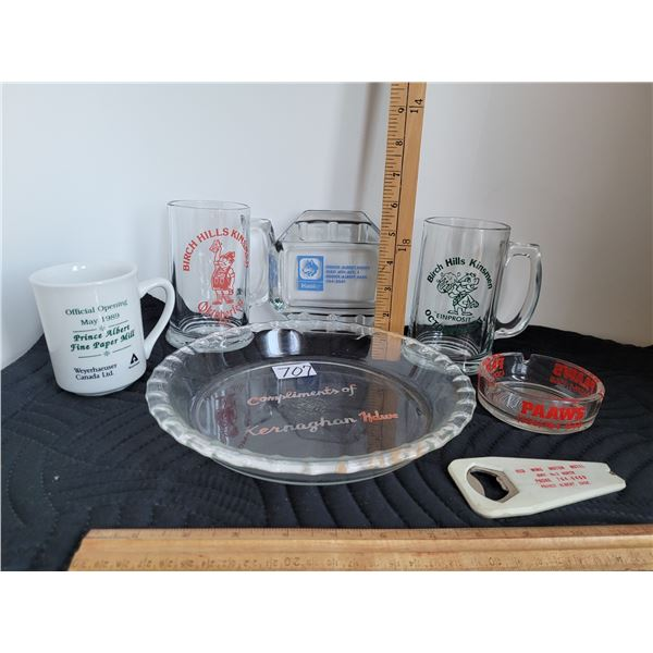 Group of vintage local advertising glassware.