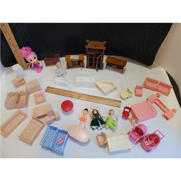 Doll furniture. 3 wooden pieces with opening doors, tiny dolls, plastic beds, tables, chairs etc.