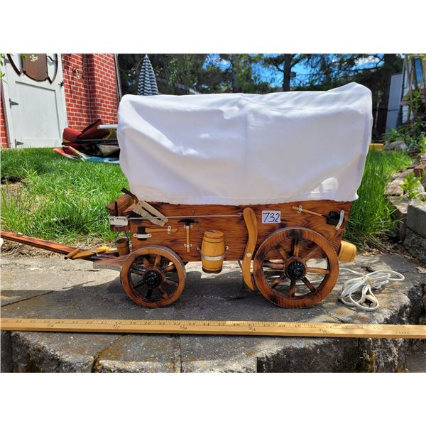Old covered wagon lamp. Artfully handcrafted with exquisite detail to all pieces.
