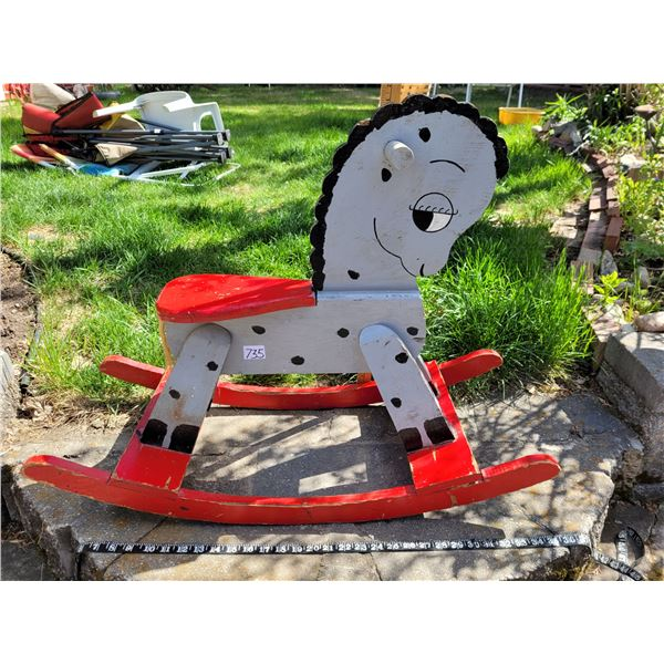 Hand crafted vintage wooden rocking horse.
