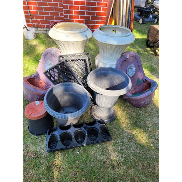 Group of outdoor flower urns and fence pots, etc.