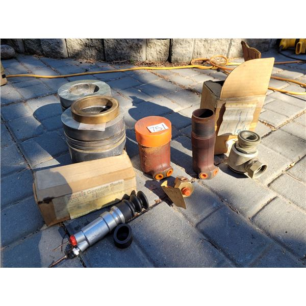 Case parts and 2 old 2470 case pistons (were used as bookends)