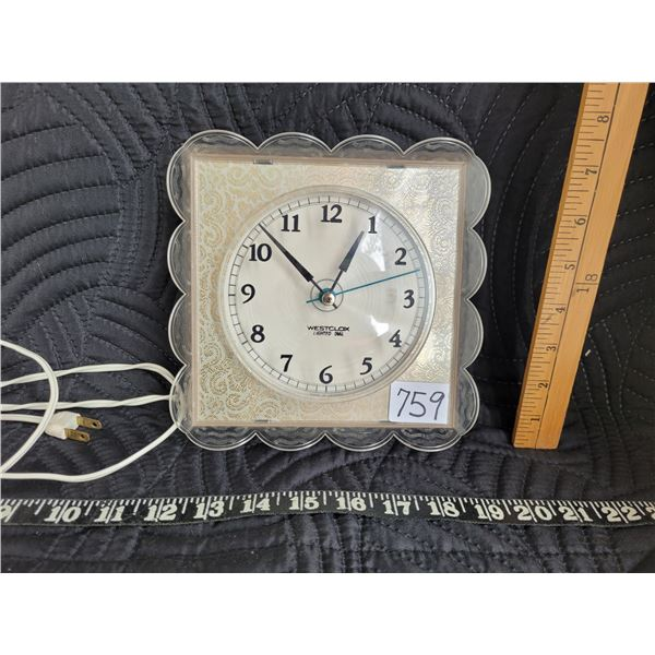 1950's Westclox lighted dial electric clock. Made in Canada.