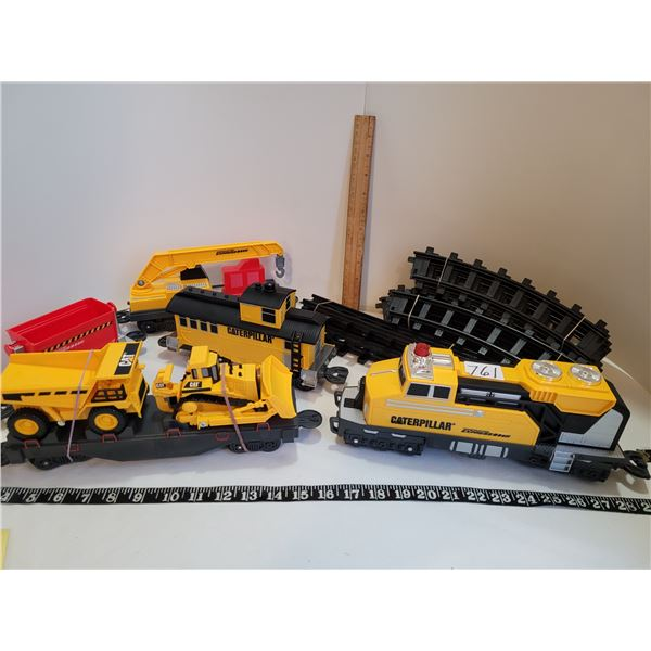 Caterpillar 5 car train & track. Crawler tractor and truck. Battery operated. Works good.