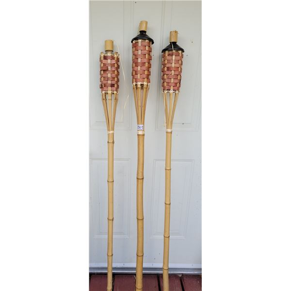 Bamboo Tiki Torches. 1 is missing top.