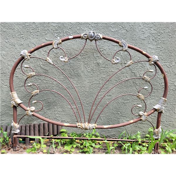 Antique Heavy bed headboard. Used as garden decor.