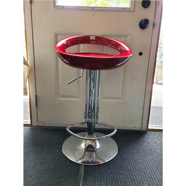 Chrome, red stool. Foot rest, swivel & hight adjustment.