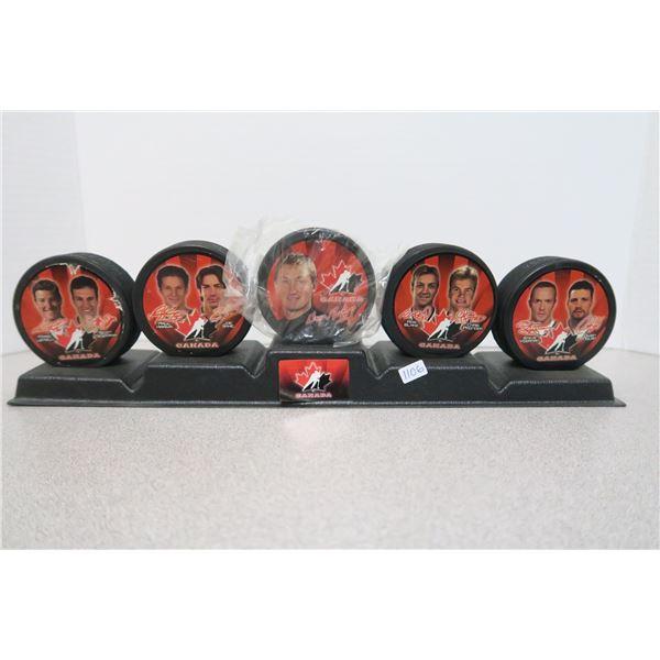 2002 McDonald's Salt Lake Collector's Hockey Pucks X5 and Display Stand