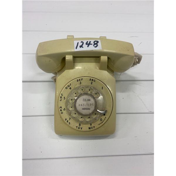 Desk top rotary telephone