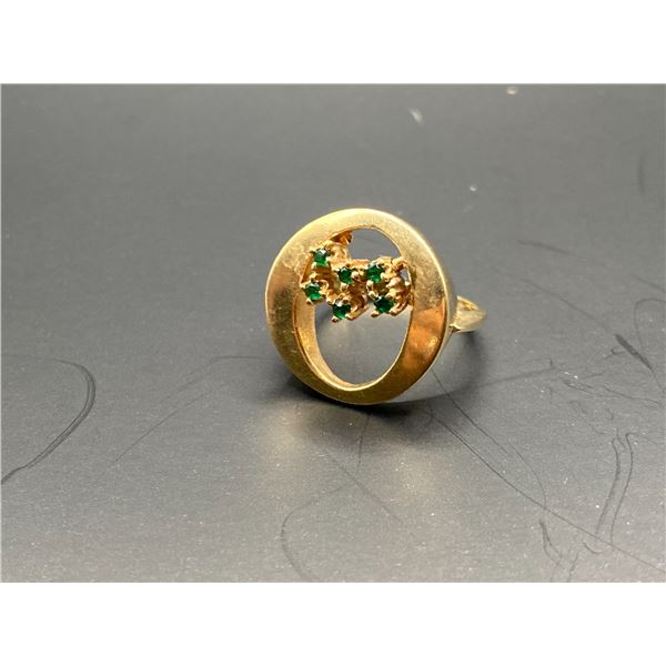 10K RING WITH GREEN STONES