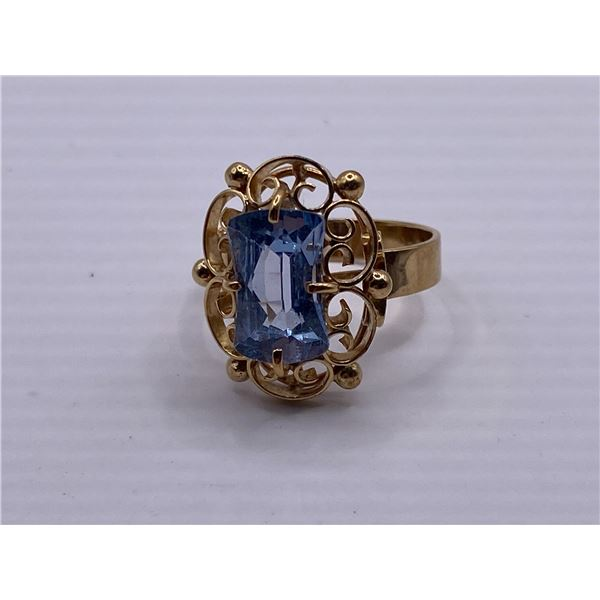 14K RING WITH PALE BLUE STONE