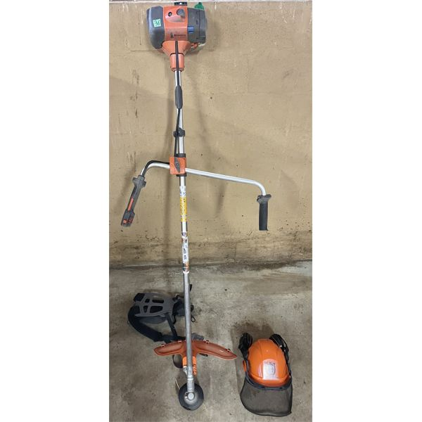 HUSQVARNA MODEL 335R GAS TRIMMER W/SAFETY HELMET, CARRY STRAP, BLADE ATTACHMENT & MANUAL.