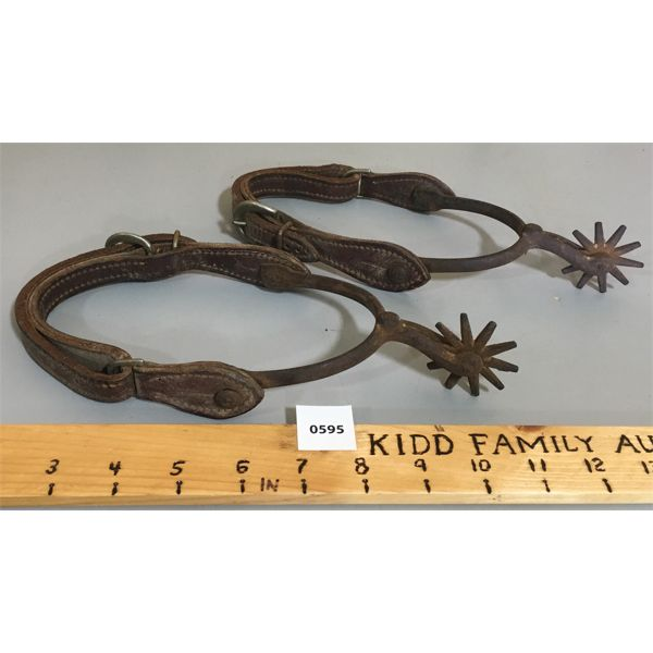 PAIR OF SPURS W/ LEATHER STRAPING