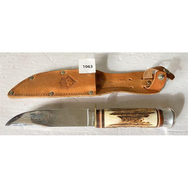 PUMA HUNTING KNIFE W/ LEATHER SHEATH - SOLINGEN WEST GERMANY GERMANY - 5 INCH BLADE. BONE HANDLE.
